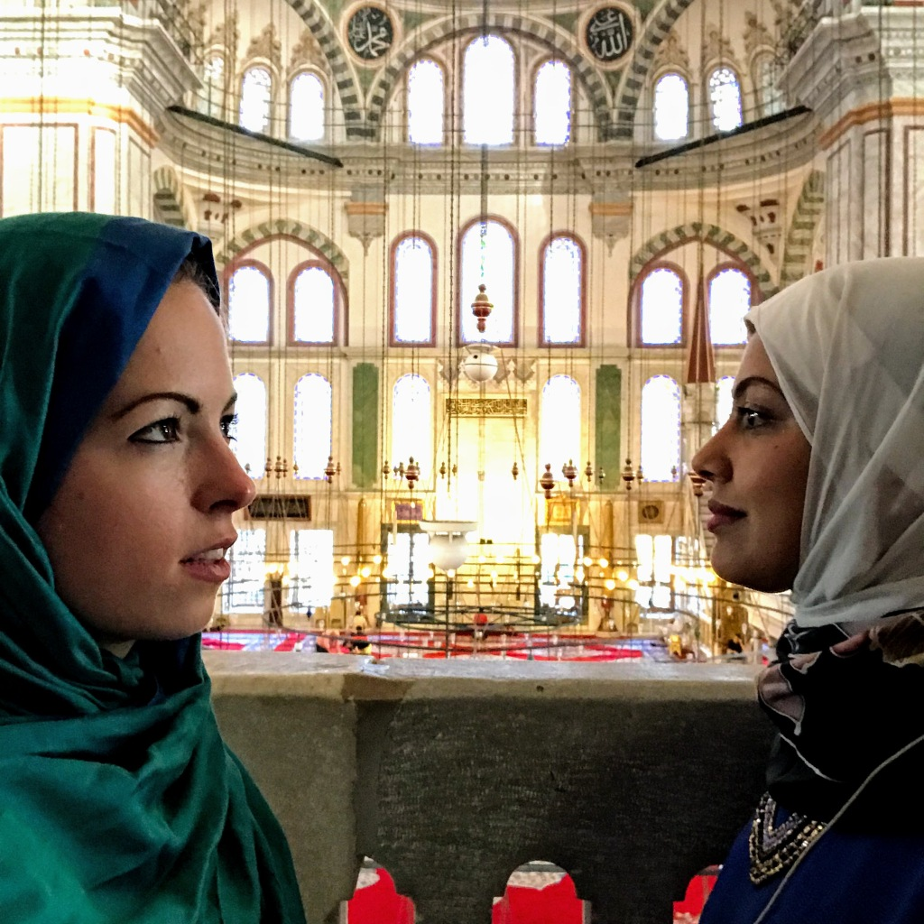 Travel Blogger Multiculti in a mosque in hijab