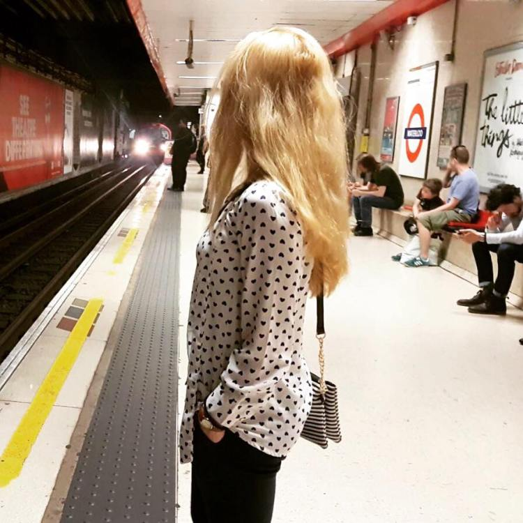 Multiculti Travel Blogger waiting for metro in London underground