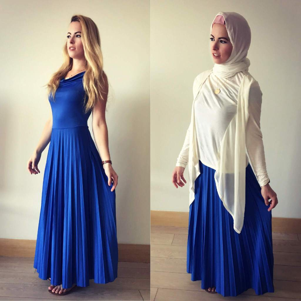 Travel Blogger Multiculti in blue dress and hijab