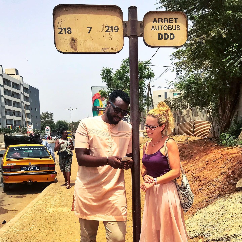 Travel blogger Multiculti waiting for the bus in Dakar