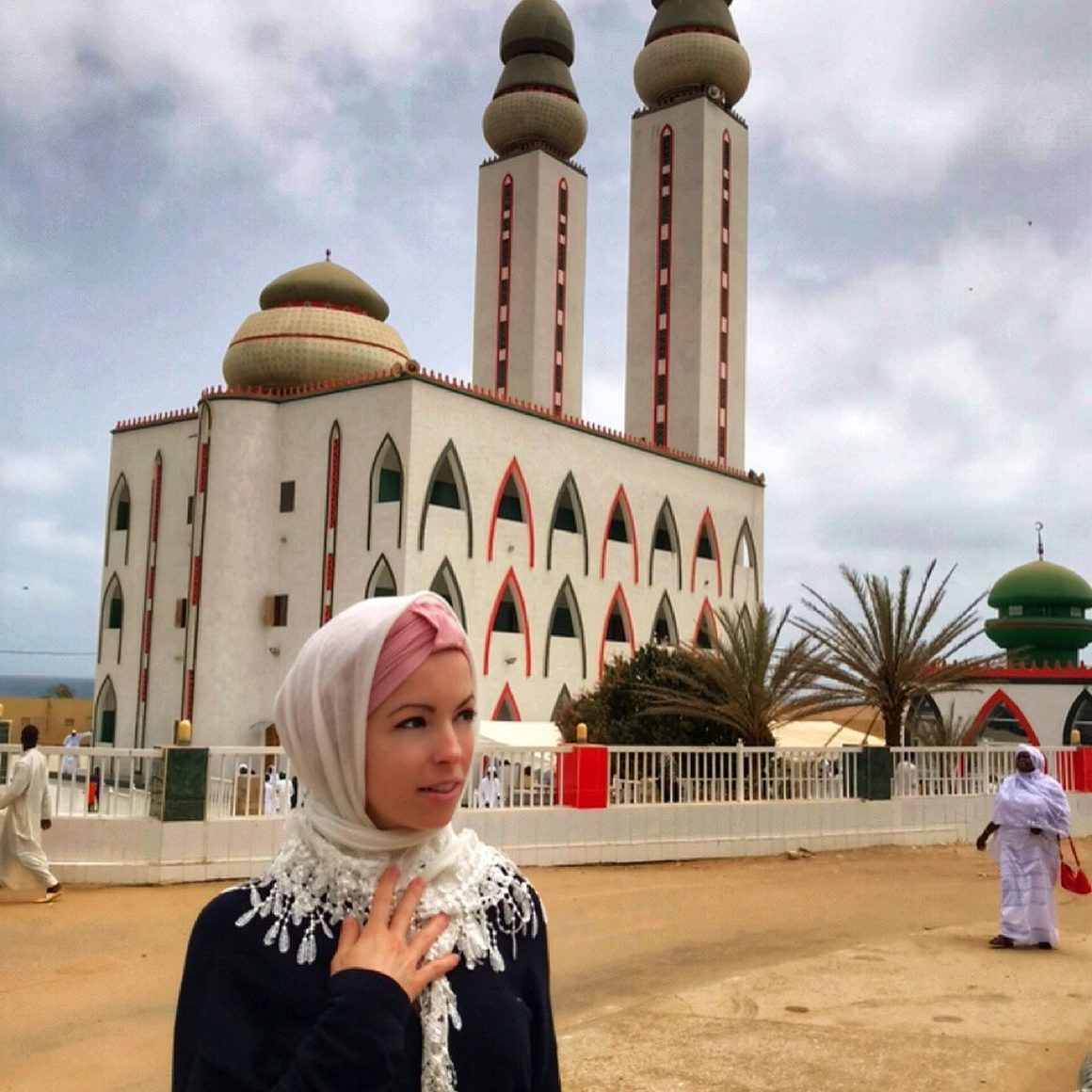 Travel blogger Multiculti in hijab in front of the mosque in Dakar Senegal